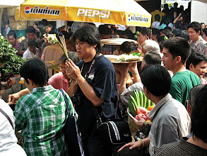 Photo: throng of worshippers outside the chapel of the Emerald Buddha