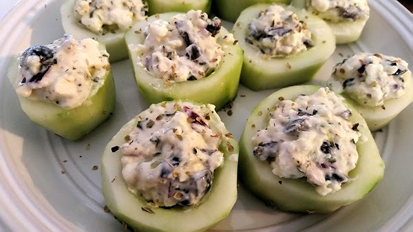 Now, stuff each cucumber round. I sprinkled with a pinch of oregano. Chill until...