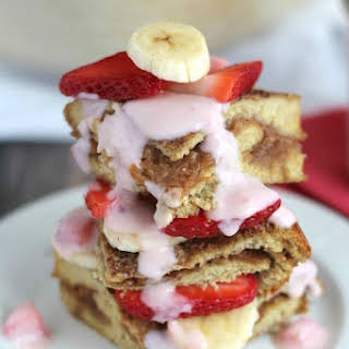 Stuffed French Toast Breakfast Casserole with Strawberries and Cream Topping.