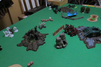 Photo: Turn 3 - end of Dark Eldar turn - The Scourges arrive from reserves and Deep Strike! With 12 shots from Splinter Carbines, they are able to take out 1 Terminator. The Khorne Berzerkers from the stuck Rhino move out and prepare to attack!