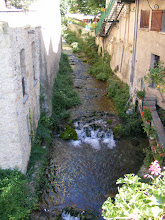 Photo: A stream from the limestone cliffs flows right through the center of town.