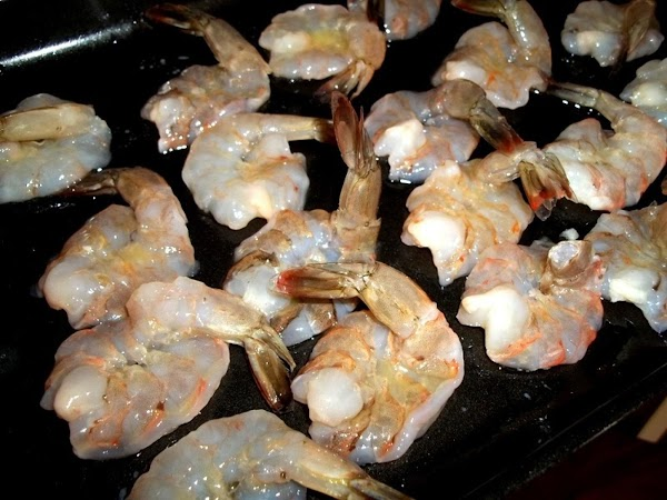 Rinse and peel shrimp, remove vein if didn't come deveined.  Cut along the bottom side...