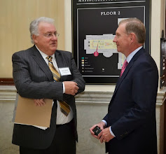 Photo: Chair of the Equal Justice Coalition John Carroll (Meehan Boyle) speaks with BBA President Paul Dacier.