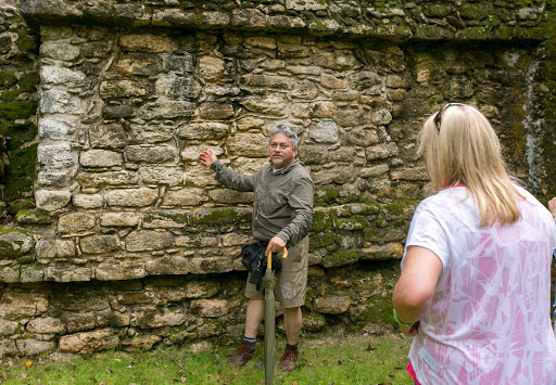 Tour guide Hugo shows a small group of visitors the Mayan ruins of Dzibanche dating to the third century A.D.