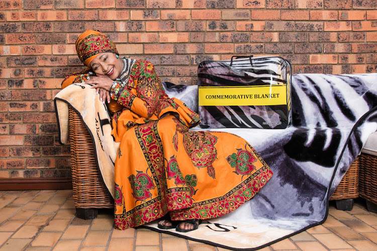 Struggle hero Winnie Madikizela-Mandela poses with the Commemorative Blanket.