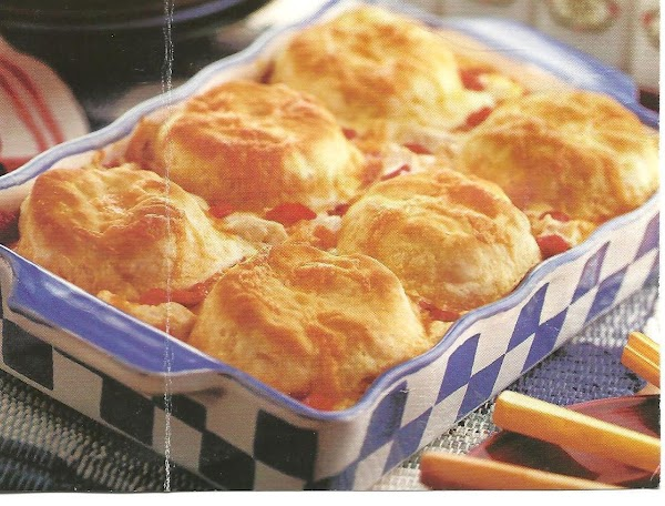 Sprinkle the dish with 3/4 cup of the cheese.  Then place the biscuits...