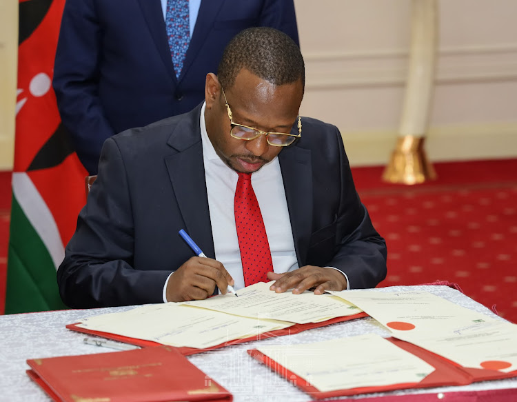 Nairobi Governor Mike Sonko signs the agreement at State House, Nairobi on February 25, 2020.