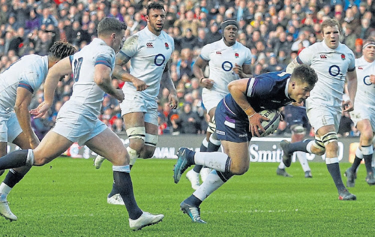 Finding the gap: Scotland centre Huw Jones, seen here scoring against England earlier in 2018, is back in the side to face the Springboks at Murrayfield on Saturday. Picture: REUTERS