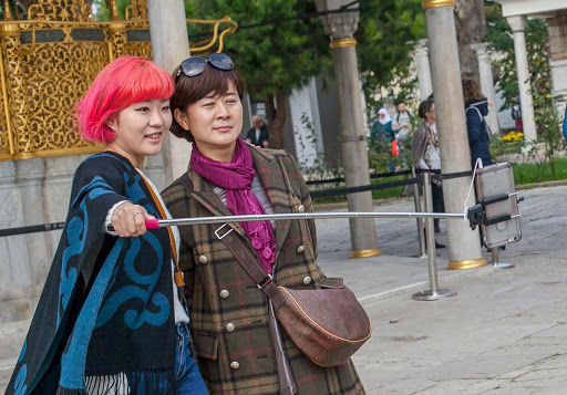 Selfie-stick-in-istanbul.jpg - A mother and daughter use a selfie stick outside Hagia Sophia in Istanbul.