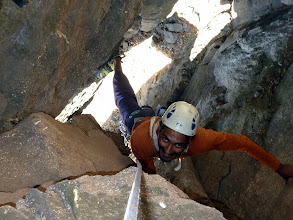 Photo: Richard Kher stemming (aka bridging in India) his way through the cave up to the hole between the chockstone belay station.
