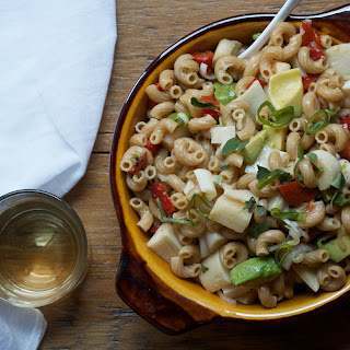 Whole Wheat Elbow Pasta Salad with Hearts of Palm, Avocado, and Red Peppers.