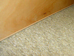 Photo: detail of Marmoleum floor and cabinet base with welting