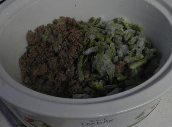 Put  beef and onions in the crockpot and add the package of frozen...