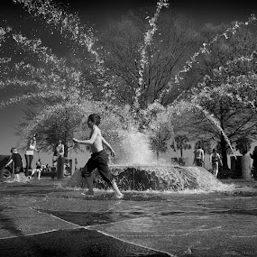 Running in Water by Alan Roseman - Black & White Street & Candid ( water, water fountain, charleston, fountain, south carolina,  )