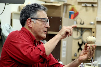 "Photo: While discussing his technique to hollowing the ""globe"" part of the ornament.