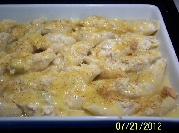 Mix soup with a little water.Pour over the shells.Cover with a sheet of aluminum.and...