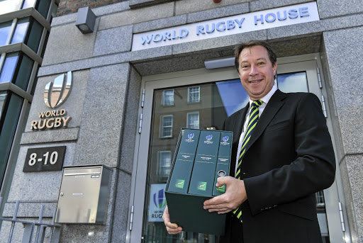 Pole position:   SA Rugby CE  Jurie Roux  arrives to  hand in SA's  bid in Dublin  on May 30.  The nation to  host the  2023 World  Cup will be  announced in  London on  Wednesday  after a secret  ballot. Gallo  Images