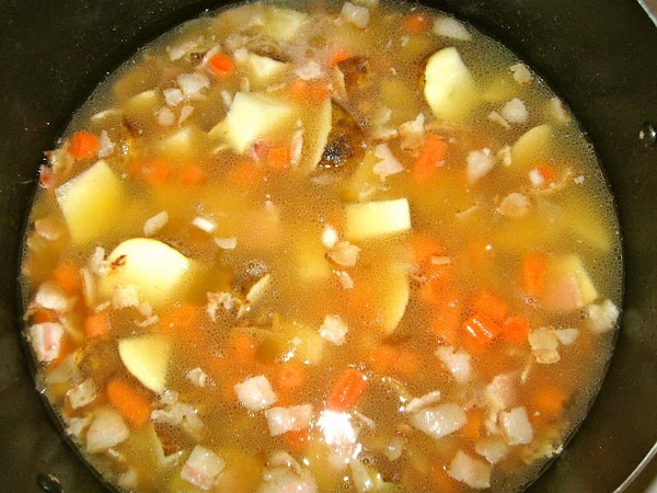 Add chicken broth.  Then mix in potatoes and carrots.  Cover and let...