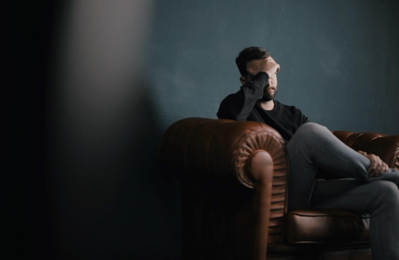 A person sitting in a chair  Description automatically generated with medium confidence