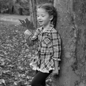 Christy and her leaf by Scott Morgan - Black & White Street & Candid ( girl child, girl, tree, black and white, leaf, leaves,  )