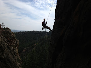 Photo: Chris George rappelling off of the Southern Dinosaur Egg