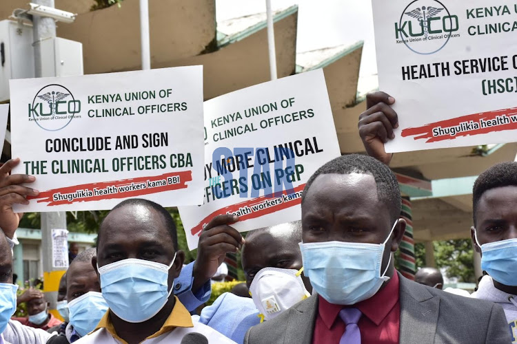 Frontline workers lead by Kenya Union of Clinical officers demonstrate due to unsigned return to work document on January 11,2021 at COG offices in Wetlands./ MERCY MUMO