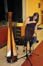 Photo: Monica Schley sets up her harp.