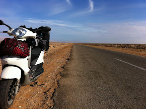 Photo: Can you tell what is behind me? More straight road.