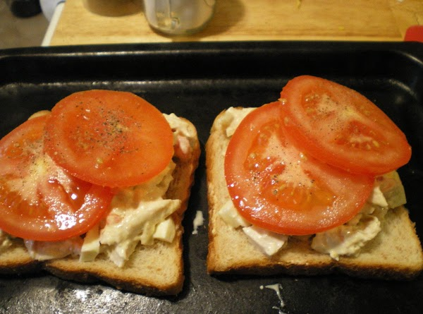 Top with tomato slices and one slice of cheese.