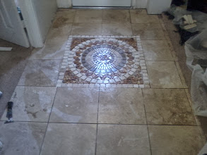 Photo: entry way with medallion install surrounded with 14x14 natural stone