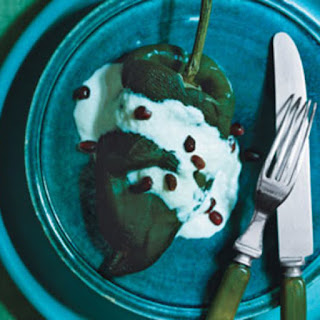 Stuffed Poblano Chiles with Walnut Sauce and Pomegranate Seeds