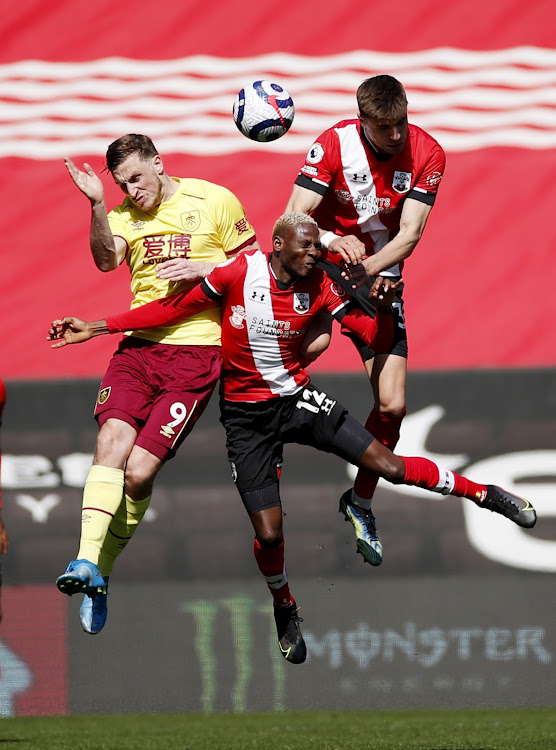 Burnley's Chris Wood in action with Southampton's Moussa Djenepo and Jan Bednarek