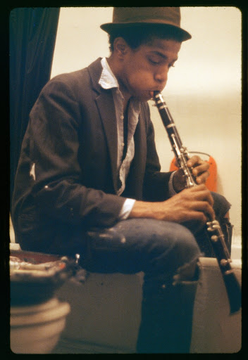 Basquiat practicing the clarinet in the bathroom