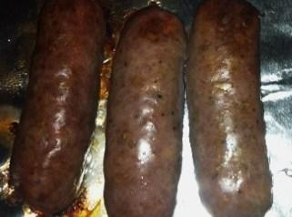 Take the sausage from the oven and slice and quarter it. Use half the...