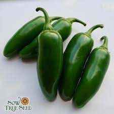 5 green jalapenos on a surface