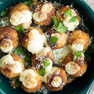 Crispy Chicken Parmesan Meatballs Stuffed with Mozzarella.