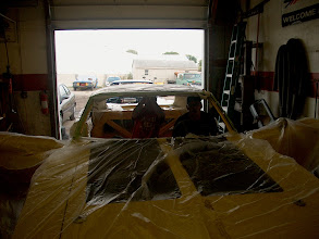 Photo: Masking the car is very important when installing the headliner because glue is sprayed everywhere. Carl and Marcus are looking cozy arent they