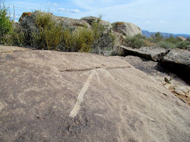 Chiseled arrow pointing to a survey marker