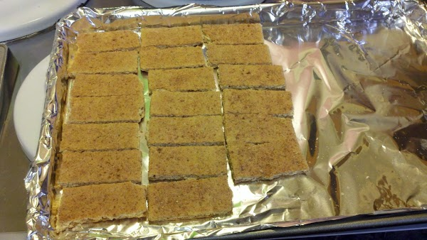 step 1 - line baking sheet with foil and cover with graham crackers.