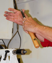 Photo: Discussing technique.  The gouge will be held between the thumb and fingers.