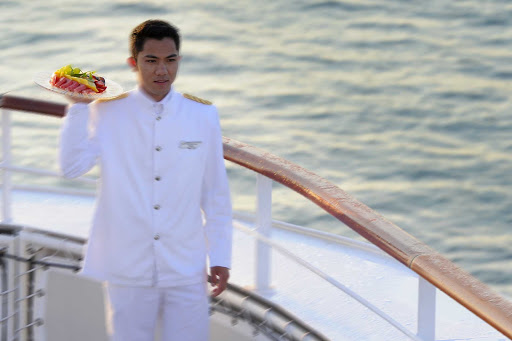 Ponant-butler-on-deck.jpg - Have a butler pamper yourself on a Ponant cruise with canapes on deck.