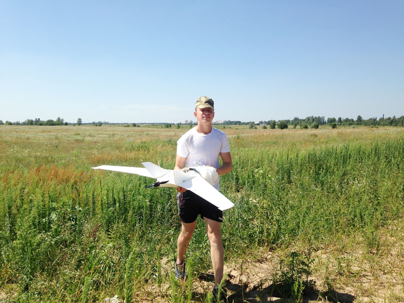 A soldier at the training center retrieves a UAV
