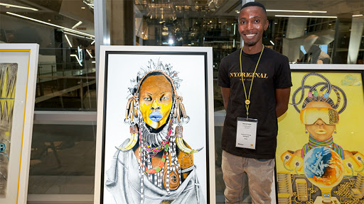 Puleng Mokagane and his artwork: 'The Prophet of the Masai'. (Photo: PaulMcGavin)