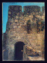 Photo: Tower that is part of the stone wall of Tarquinia