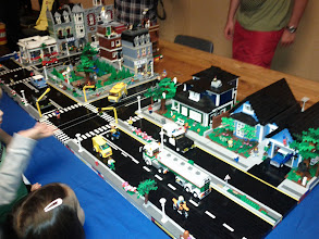 Photo: Town scene. Road made with sideways black and white blocks.