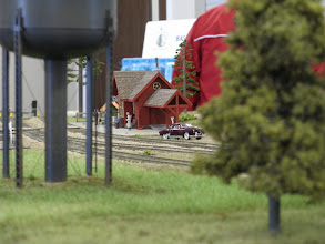 Photo: A sedan and its driver wait for the passenger train to arrive at Muskoka.