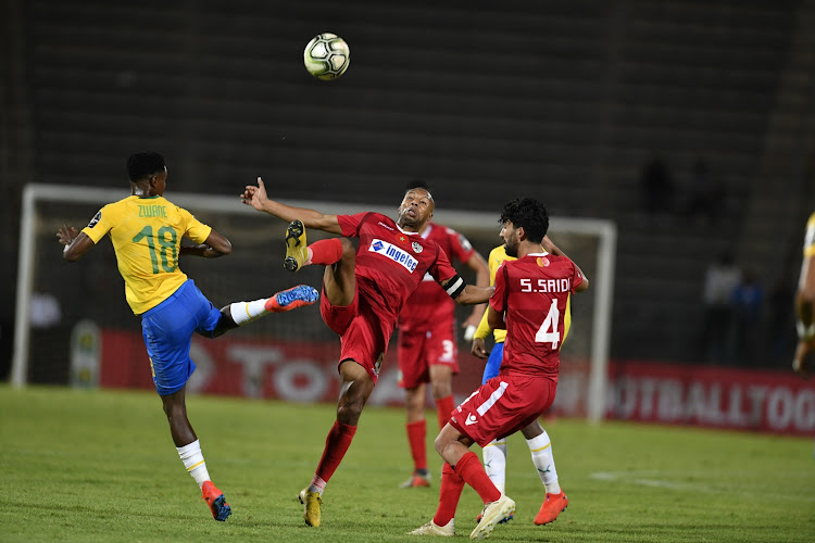 Themba Zwane of Mamelodi Sundowns and Brahim Nakach of Wydad Athletic Club during the CAF Champions League match between League: Mamelodi Sundowns and Wydad Athletic Club at Lucas Moripe Stadium on January 19, 2019 in Pretoria, South Africa.