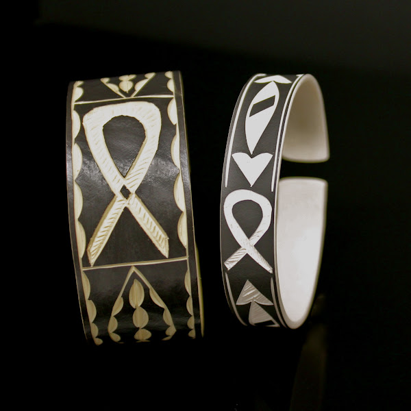 Photo: African Art Bracelet – $25.00  Hand-carved in the Ovahimba tribal tradition by villagers in Namibia, no two African Art bracelets are alike. Each bracelet features a representation of the AIDS ribbon, and each is a poignant work of wearable art imaginatively and resourcefully crafted from recycled PVC pipe.   Your purchase of this unique bracelet provides care services, food, and schooling for children of this Namibian village and other areas of Africa ravaged by AIDS. Buy it for yourself or as a memorable gift. Each bracelet is a showpiece, full of meaning and depth, and worn with the hopes of eradicating this disease forever.