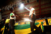 Cyril Ramaphosa and Jacob Zuma walk towards each other for a handshake at the ANC's 54th Elective Conference at Nasrec in Johannesburg on the 18 December 2017.
