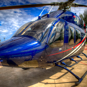 The Blue by Mohamad Sa'at Haji Mokim - Transportation Helicopters ( helicopter, tree, blue, land, transportation )
